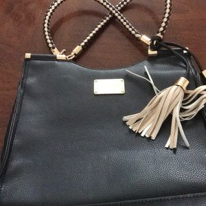 Large Bebe bag.  With tassels and brass accents.